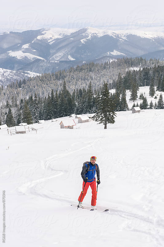 Cross-country skier moving uphill by RG&B Images for Stocksy United