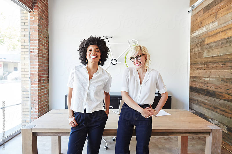 Portrait of millennial businesswomen in office by Trinette Reed for Stocksy United