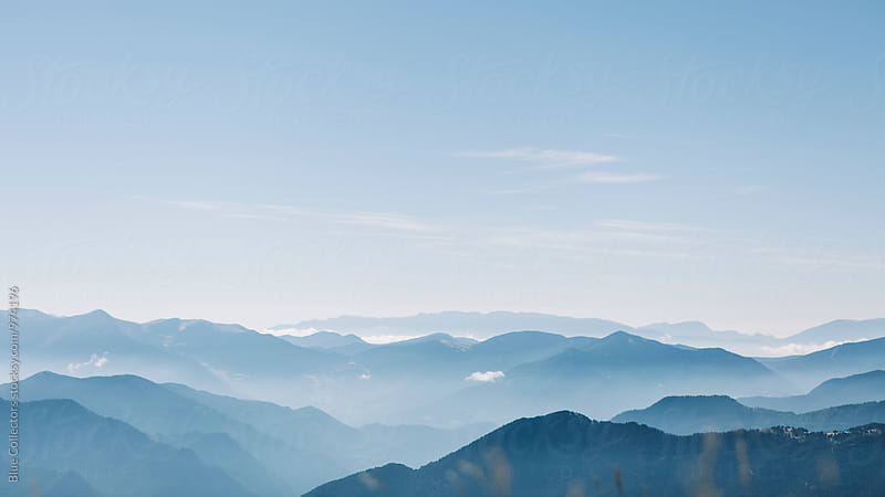 A view of the horizon above the cloudy morning in the mountains by Jordi Rulló for Stocksy United