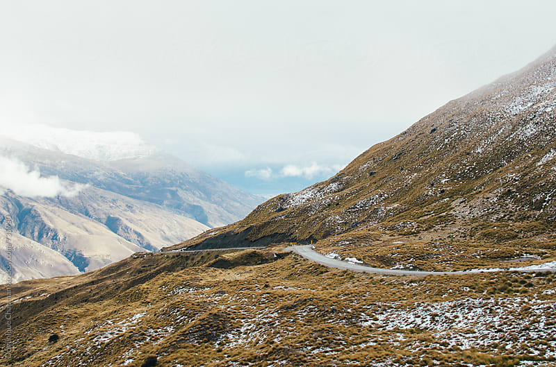 Windy road of the highlands in New Zealand by Dominique Chapman for Stocksy United