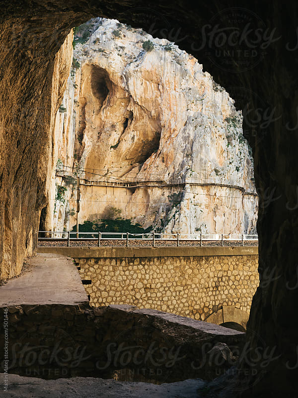 camino del rey pathway framed in rock arch by Martin Matej for Stocksy United