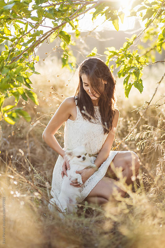 Young woman proud of her dog by Eva Plevier for Stocksy United