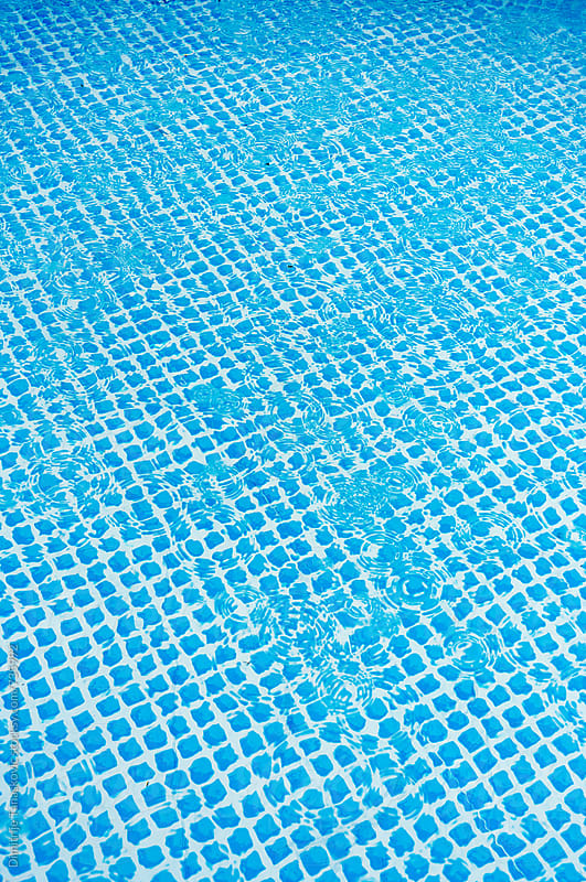 Rain falling on water surface in the pool by Dimitrije Tanaskovic for Stocksy United
