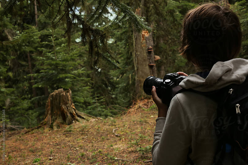 Tourist with camera at forest by Milles Studio for Stocksy United