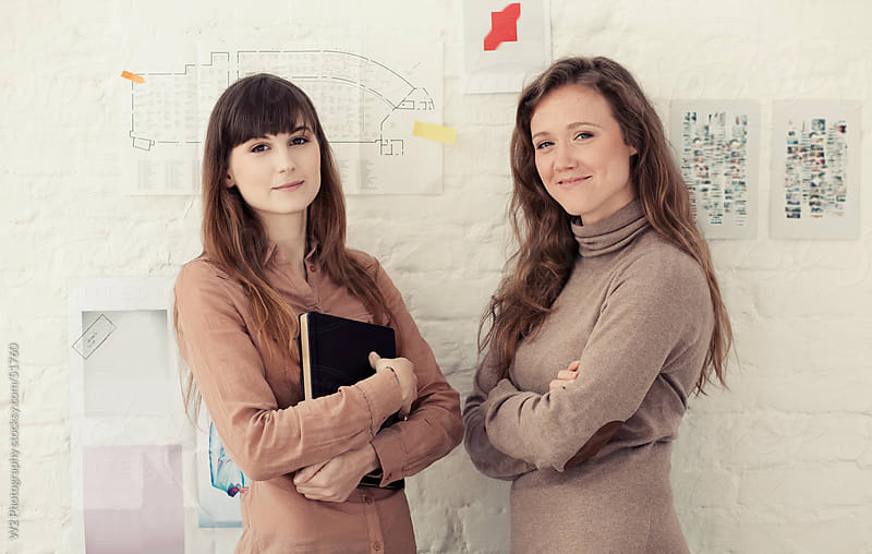Portrait of two businesswomen in an office. by W2 Photography for Stocksy United