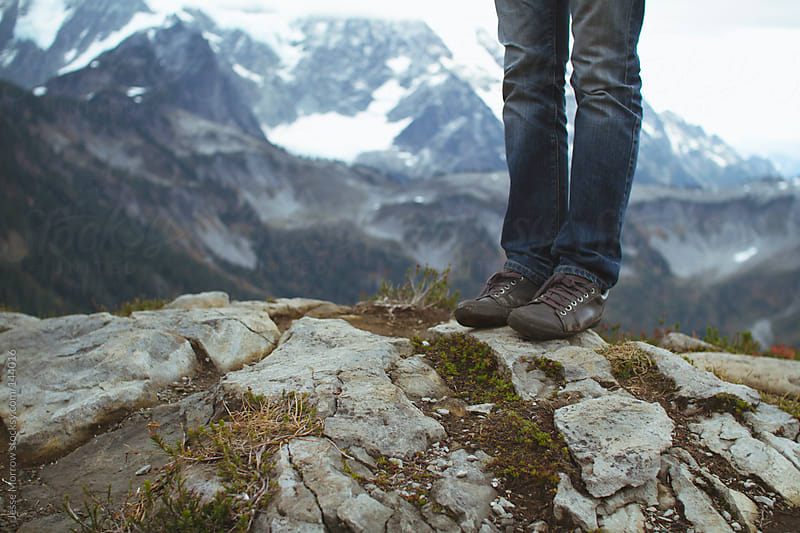 Standing on the edge by Jesse Morrow for Stocksy United