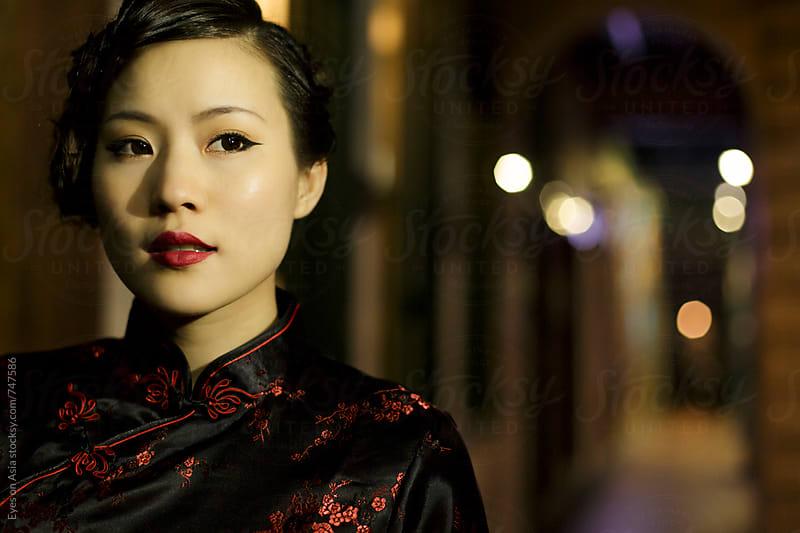 Chinese woman in cheongsam by Felix Hug for Stocksy United