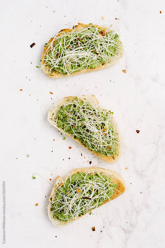 Spring Pea Roasted Garlic Bruschetta by Cameron Whitman for Stocksy United