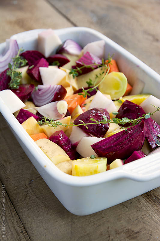Baking dish with fall vegetables by Harald Walker for Stocksy United