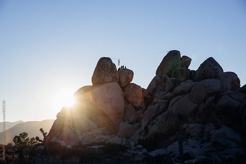 rock climbers slack liners in joshua tree national park sunset by Jeremy Pawlowski for Stocksy United
