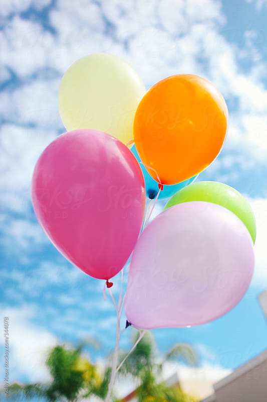 bunch of bright balloons by Kelly Knox for Stocksy United