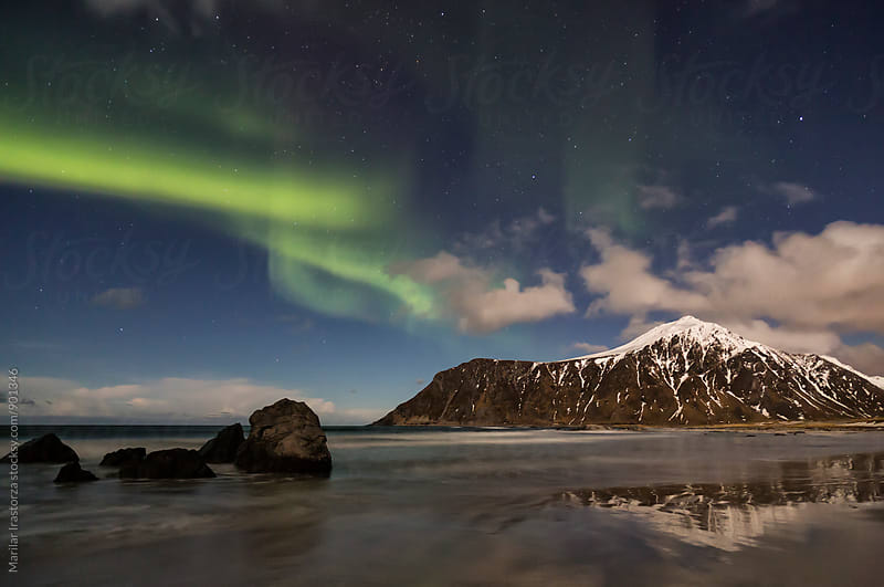 Northern Lights over a norwegian beach by Marilar Irastorza for Stocksy United