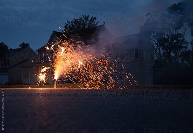 Fireworks in typical American neighborhood on 4th of July by Brian McEntire for Stocksy United