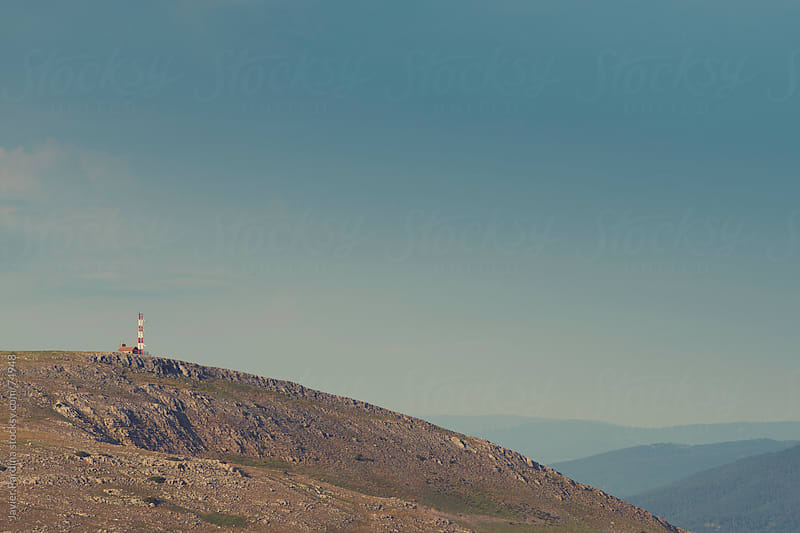 landscape with antenna on top of the mountain by Javier Pardina for Stocksy United