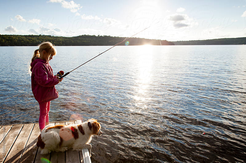 Little girl fishing from dock on cottage lake with dog by for Little girl fishing pole