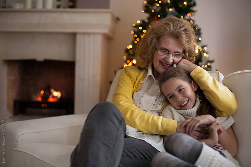 Grandmother and Granddaughter at Christmas by Lumina for Stocksy United