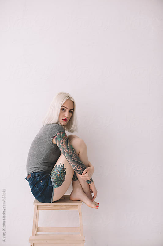 portrait of young lady on the white background by Vesna for Stocksy United