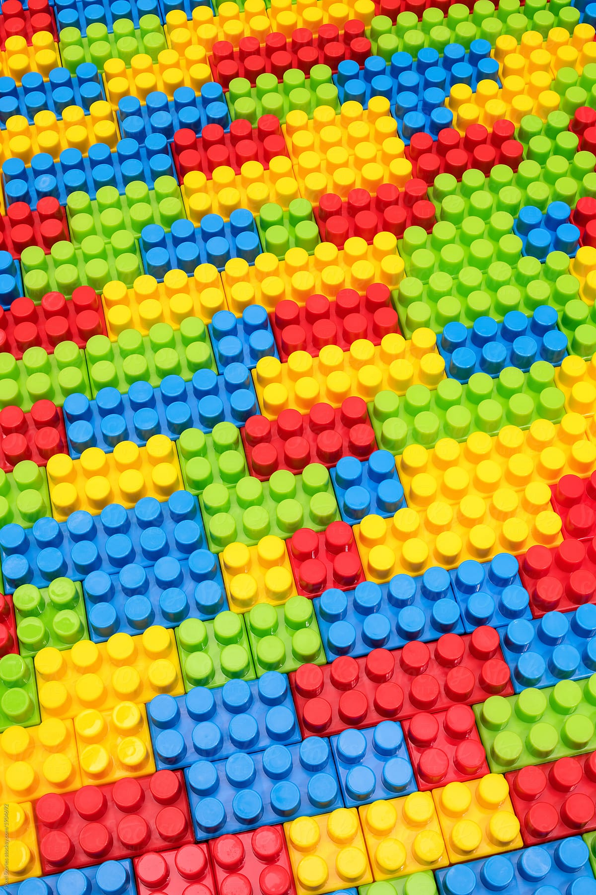 Stock Photo - Colorful Plastic Building Blocks Background