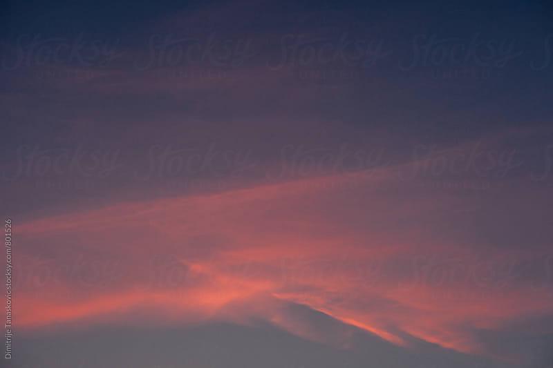 One cloud in the evening sky by Dimitrije Tanaskovic for Stocksy United