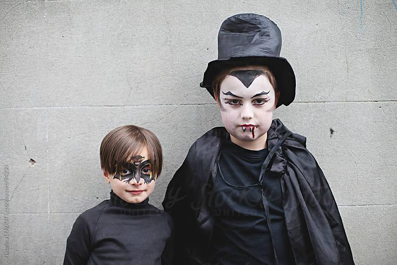 Children dressed up as bat and vampire for Halloween by Natalie JEFFCOTT for Stocksy United