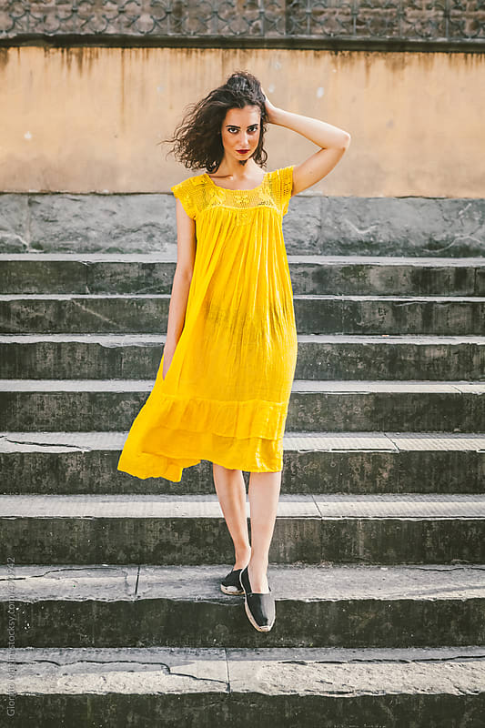 Young Woman with Yellow Dress Descending an Old Staircase by Giorgio Magini for Stocksy United