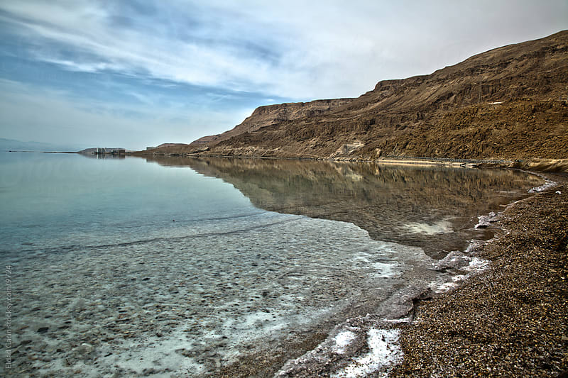 Dead Sea Shore and Mountains with Reflection by Eldad Carin for Stocksy United
