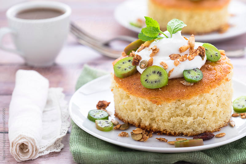 Pound Cake Topped with Yogurt, Kiwi Berries, and Granola by Nicole S. Young for Stocksy United