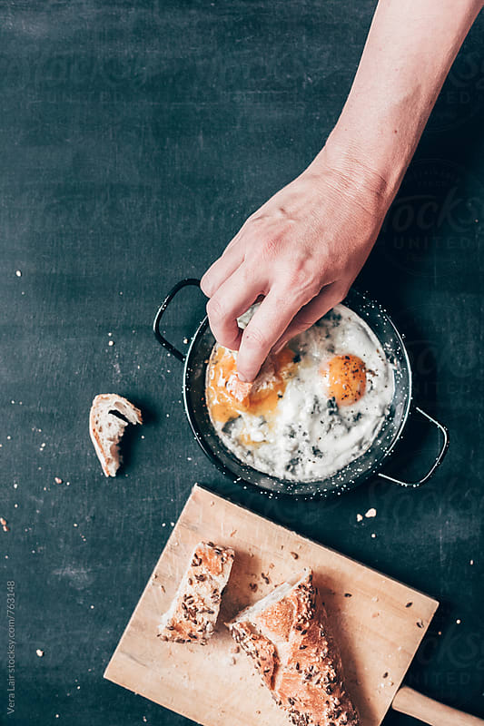 A simple recipe for eggs with blue cheese by Vera Lair for Stocksy United