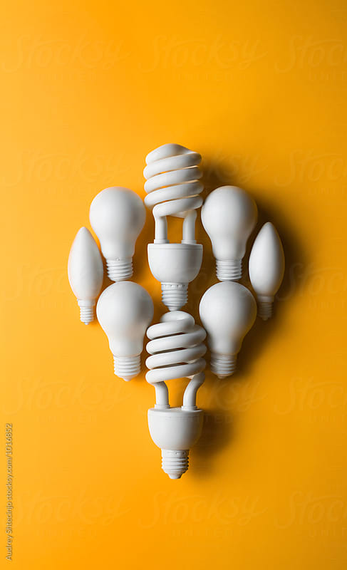 Organized bulb lights making one big bulb light. by Audrey Shtecinjo for Stocksy United