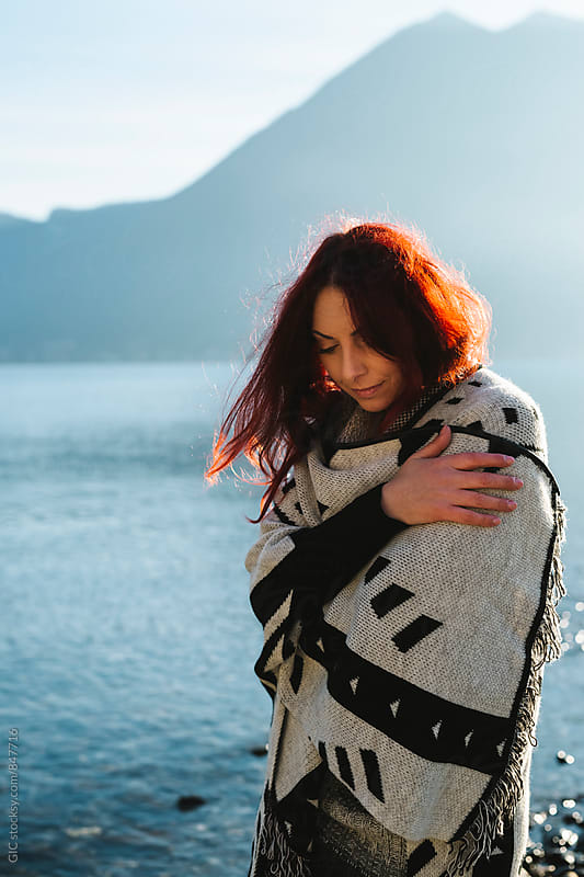Beautiful woman outdoors across the lake by WAVE for Stocksy United