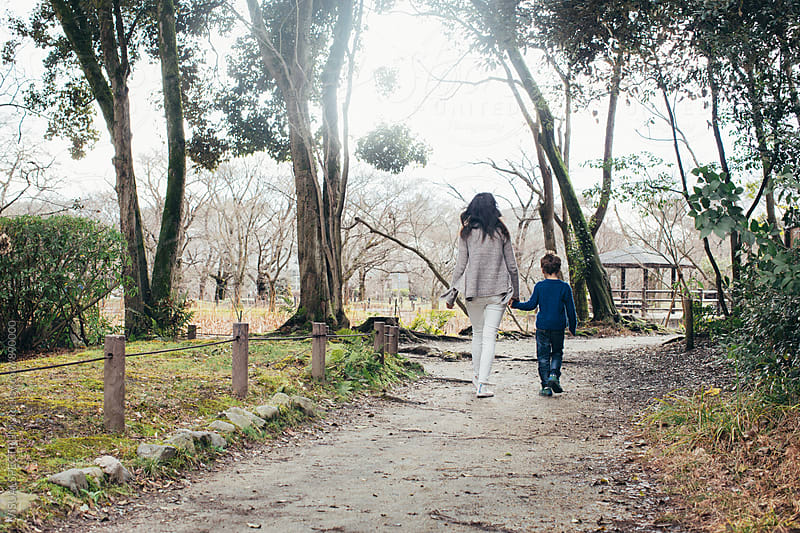 Family Outing - Mother and Son Walking on Forest Path by VISUALSPECTRUM for Stocksy United