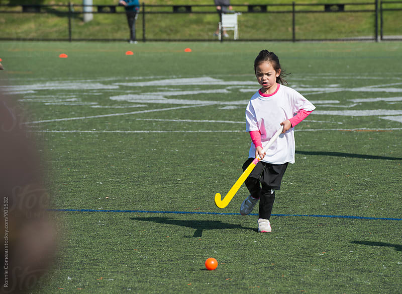 Little Field Hockey Player by Ronnie Comeau for Stocksy United