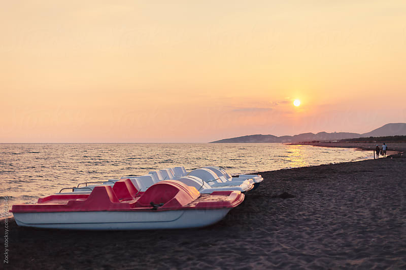 Pedal boats on the beach by Zocky for Stocksy United