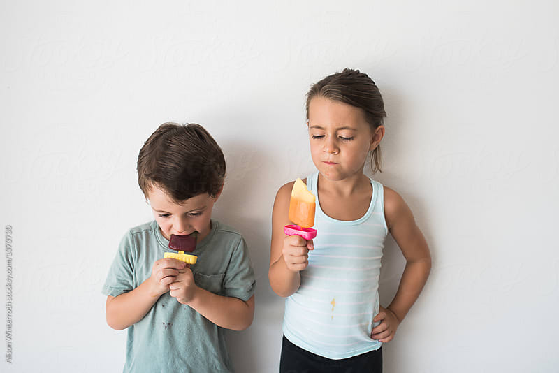 Two Children Eating Popsicles by Alison Winterroth for Stocksy United