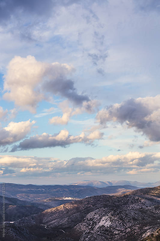 A Cloudy Sky over a Mountainous Terrain by Helen Sotiriadis for Stocksy United