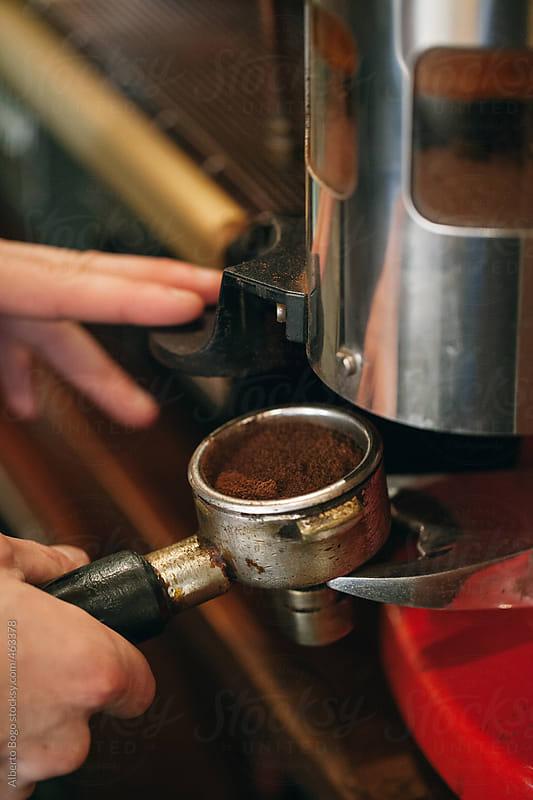 Barista making espresso by Alberto Bogo for Stocksy United