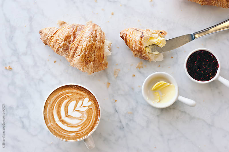 croissant and coffee by Gillian Vann for Stocksy United