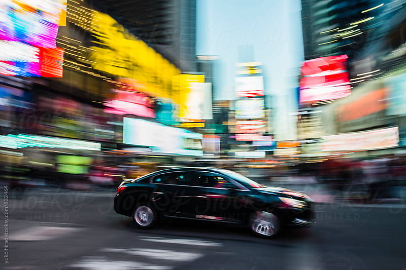 Car, driving through neon of Times Square at night by yuko hirao for Stocksy United
