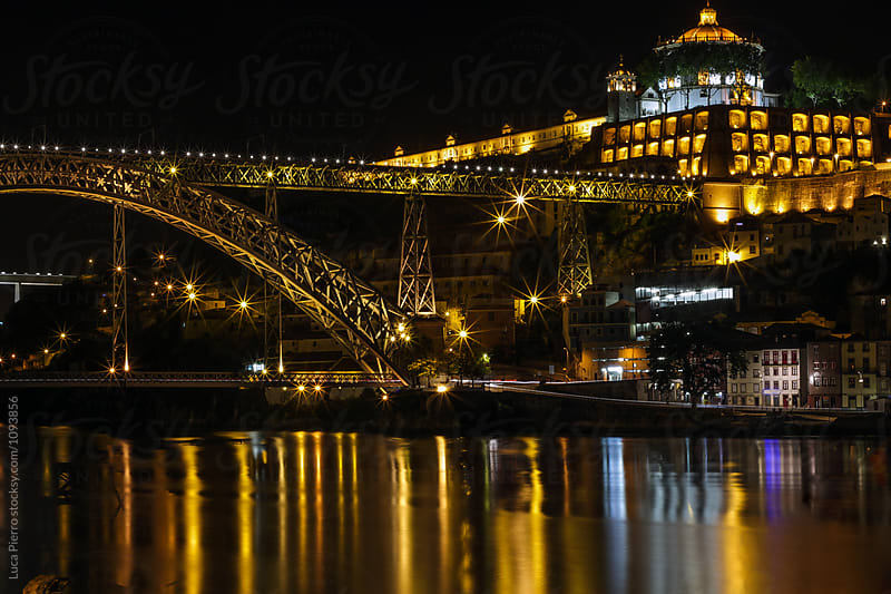 Ribeira and Douro river at night, Porto, Portugal by Luca Pierro for Stocksy United