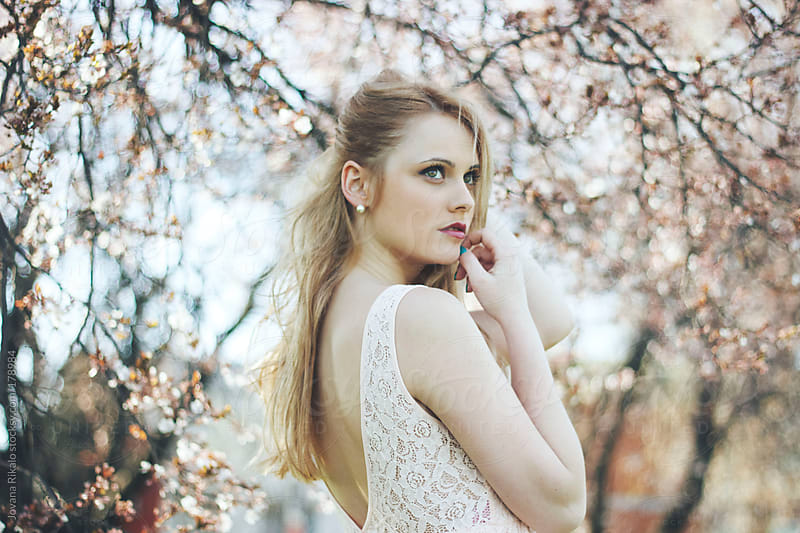 Potrait of a beautiful young woman in nature by Jovana Rikalo for Stocksy United