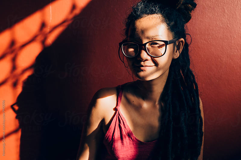 Portrait of a Thai Woman With Dreadlocks by Nemanja Glumac for Stocksy United