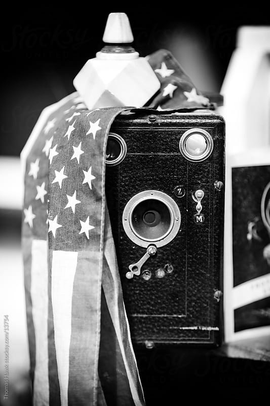 Old film camera and American Flag by Thomas Hawk for Stocksy United