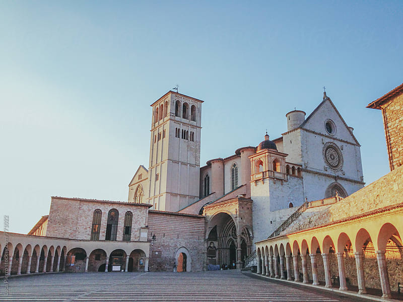 Famous Basilica of St. Francis of Assisi with Lower Plaza at sunset by Luca Pierro for Stocksy United