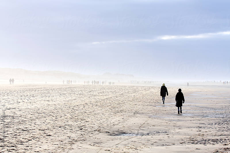 Beach in Belgium crowded with walking people by Marcel for Stocksy United