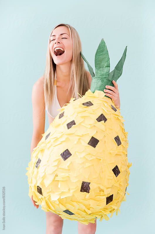 Woman with a pineapple pinata  by Ivan Solis for Stocksy United