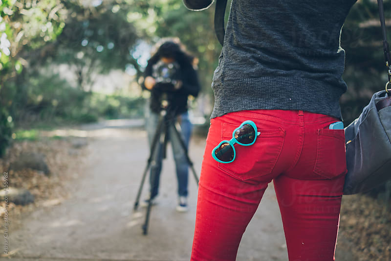 Red pants and blue glasses by Arthur Chang for Stocksy United