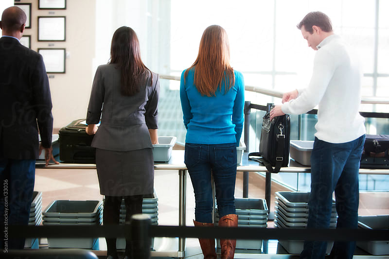 Airport: People in Line at Airport Security Table by Sean Locke for Stocksy United