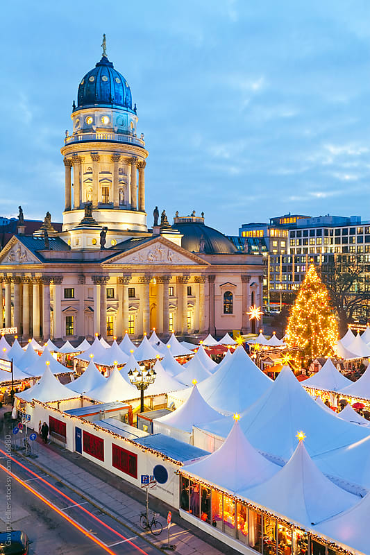 Europe, Germany, Berlin, traditional Christmas Market at Gendarmenmarkt  - elevated view illuminated at dusk by Gavin Hellier for Stocksy United