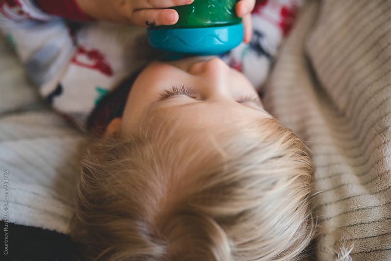 Close up of boy drinking by Courtney Rust for Stocksy United