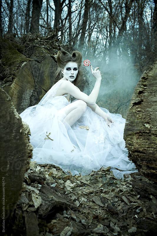 Fairy in white dress in blue forest by Bratislav Nadezdic for Stocksy United